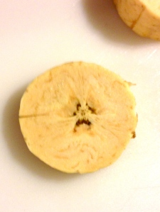 ; Anthropomorphic worried plantain slice.