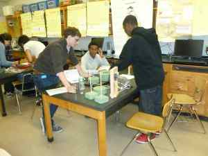 Students at Newburgh Free Academy working on their experiment